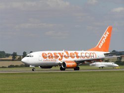 Photograph of Easyjet Boeing 737 on the runway at Luton Airport