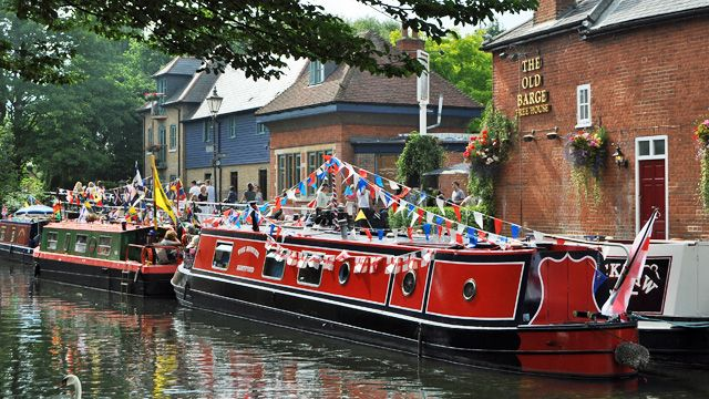 Photo of decorated narrowboats moored up outside The Barge public house in The Folly, Hertford<br />Photograph: Steve Beeston